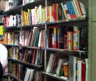and a wall of cookbooks in one side