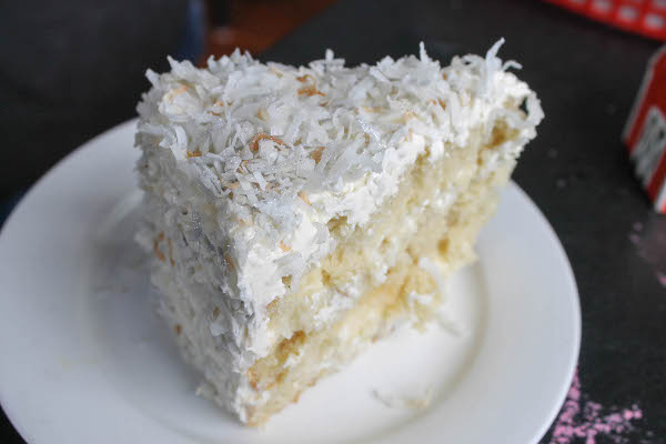 Coconut cream cake with a custard filling, coconut buttercream ...