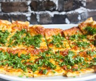 garlic and cheese flatbread with herbs