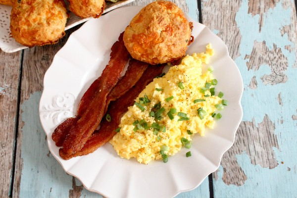 breakfast plate scrambled eggs bacon biscuit